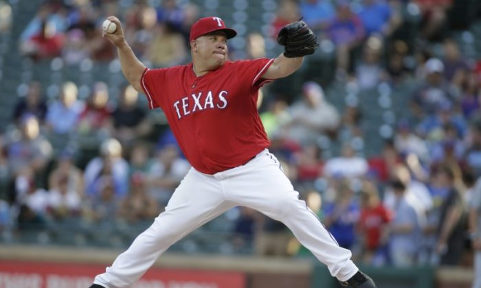 Aug 7, 2018; Arlington, TX; Texas Rangers starting pitcher Bartolo Colon (40) pitches against the Seattle Mariners in the first inning. (Tim Heitman-USA TODAY Sports)