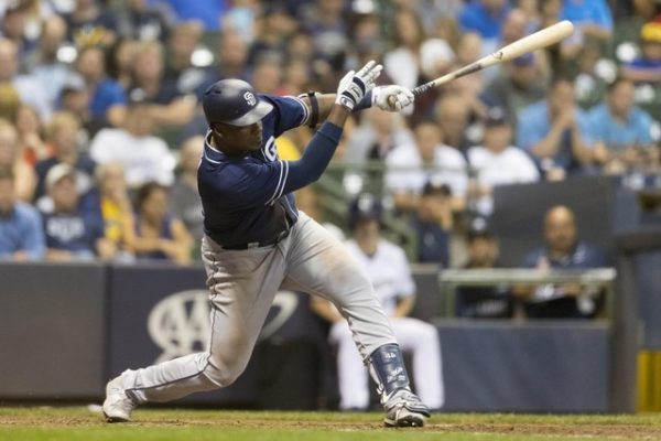 Aug 7, 2018; Milwaukee, WI; San Diego Padres right fielder Franmil Reyes hits an two run double during the seventh inning against the Milwaukee Brewers. (Jeff Hanisch-USA TODAY Sports)