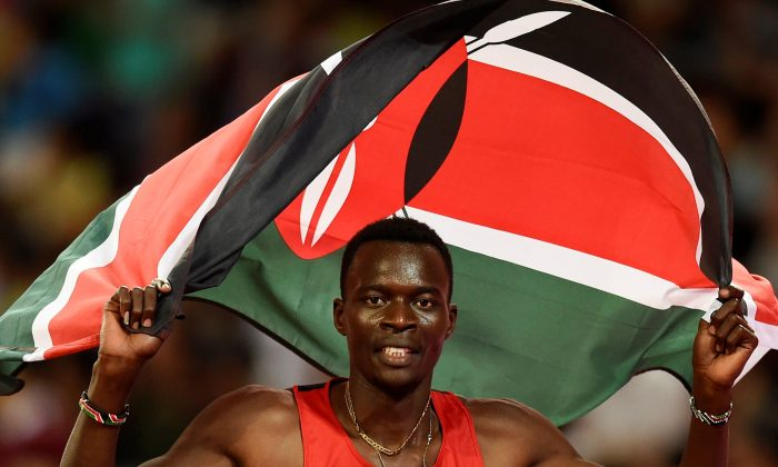 Nicholas Bett of Kenya celebrates with his national flag after winning the men's 400 meters hurdles final during the 15th IAAF World Championships at the National Stadium in Beijing, China Aug. 25, 2015. (Reuters/Dylan Martinez/File Photo)