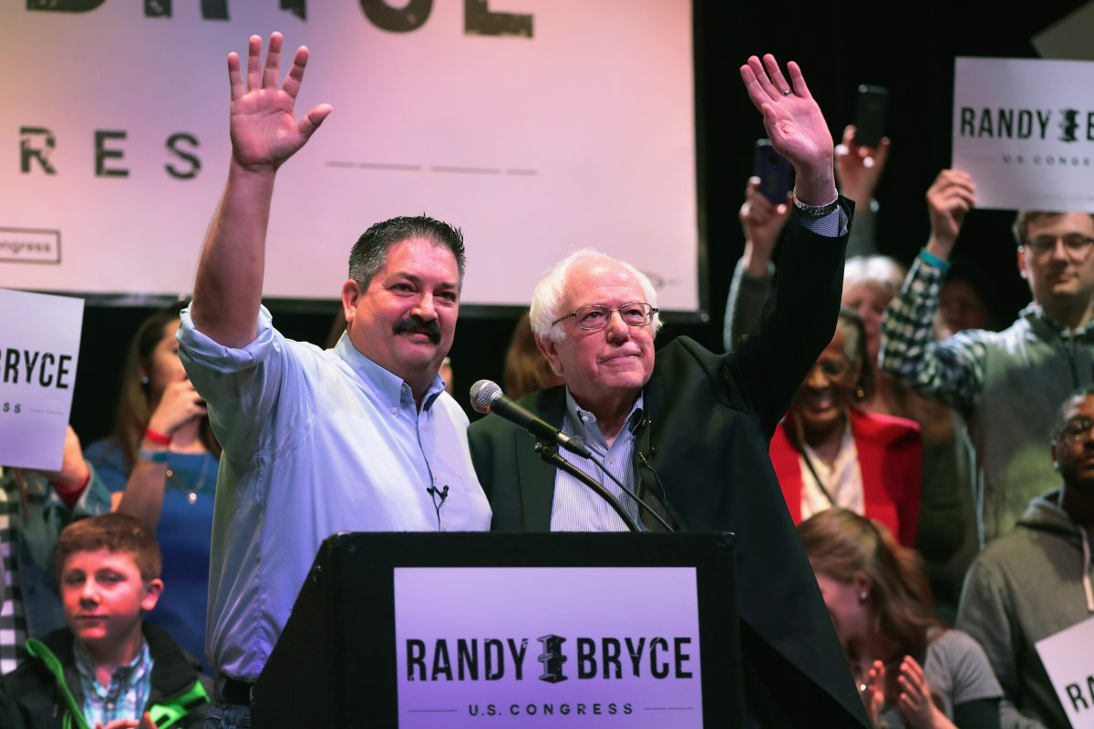 Socialist Sen. Bernie Sanders (I-VT) (right) campaigns with congressional candidate Randy Bryce at a rally on Feb. 24, 2018 in Racine, Wisconsin. Bryce takes left-wing positions and is referred to by Wisconsin Republicans as a socialist. (Scott Olson/Getty Images)
