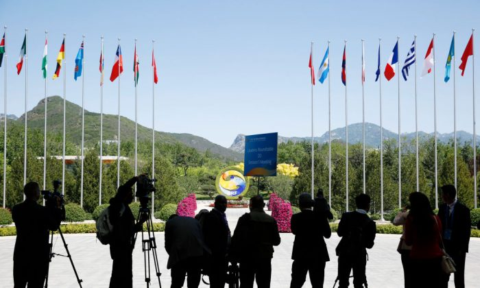 Journalists take pictures outside the venue of a summit at the Belt and Road Forum in Beijing on May 15, 2017 (Thomas Peter-Pool/Getty Images)