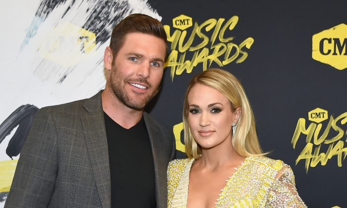 Mike Fisher (L) and Carrie Underwood attend the 2018 CMT Music Awards at Bridgestone Arena in Nashville, Tennessee, on June 6, 2018. (Rick Diamond/Getty Images for CMT)