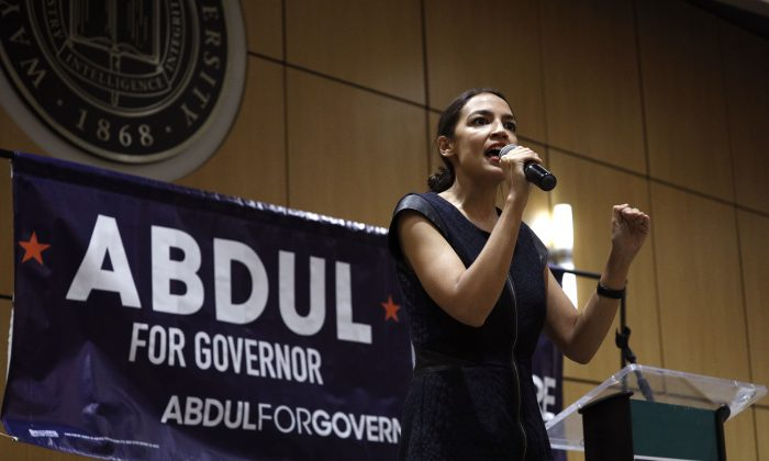 New York Democrat candidate for Congress and socialist Alexandria Ocasio-Cortez campaigns for Michigan Democratic gubernatorial candidate Abdul El-Sayed at a rally on the campus of Wayne State University July 28, 2018 in Detroit, Michigan. Sayed ran on left-wing policies and won 33 percent in a three-way primary on Aug. 8, losing to the liberal Gretchen Whitmer. (Bill Pugliano/Getty Images)