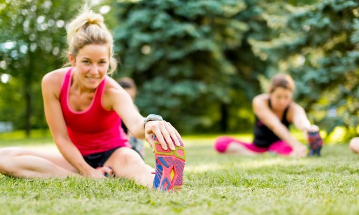 Many athletes stretch before and after exercise, but they may not be gaining benefits from doing so. (ESB Basic/shutterstock)