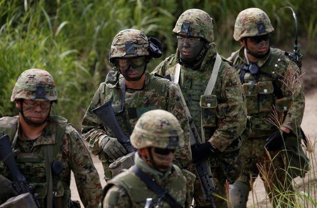 File Photo: Japan Ground Self Defense Force members take part in their joint exercise, named Northern Viper 17, with U.S. Marine Corps at Hokudaien exercise area in Eniwa, on the northern island of Hokkaido, Japan, August 16, 2017.  (Reuters/Toru Hanai)