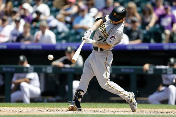 Pittsburgh Pirates Adam Frazier hits a double in the third inning against the Colorado Rockies.