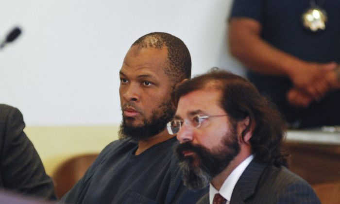 Siraj Ibn Wahhaj (L) sits next to public defense attorney Aleks Kostich at a first appearance in New Mexico state district court in Taos, N.M. on Aug. 8, 2018. (AP Photo/Morgan Lee)