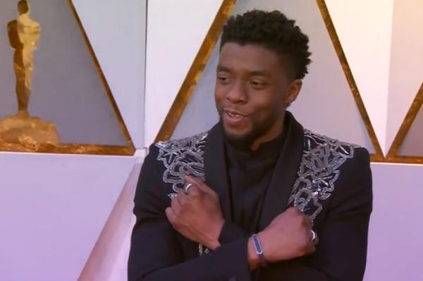 Chadwick Boseman poses during Oscars red carpet.