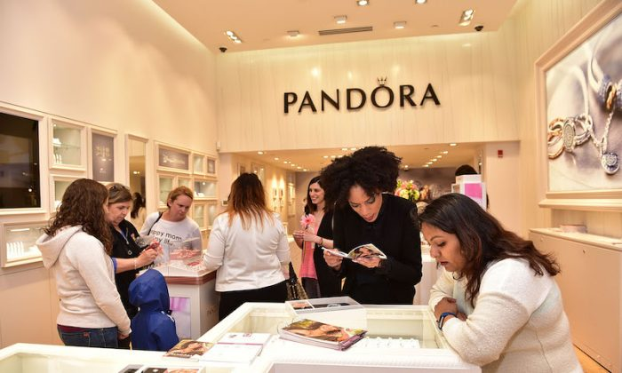 Customers shopping at PANDORA jewelery store during Grand Opening on May 21, 2016 in Philadelphia, Pennsylvania. (Photo by Lisa Lake/Getty Images for PANDORA)