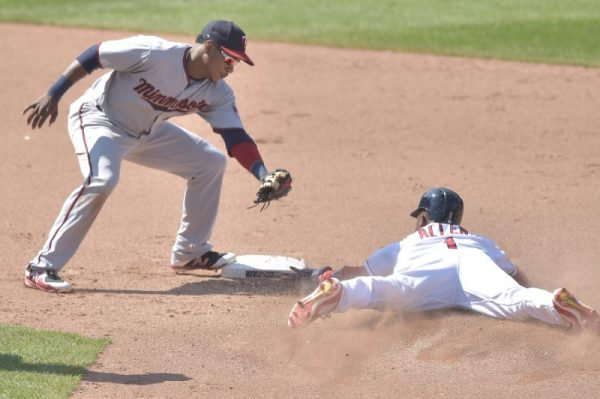 Cleveland Indians center fielder Greg Allen steals second base beside Minnesota Twins shortstop Jorge Polanco in the ninth inning.