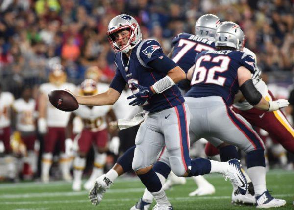 New England Patriots quarterback Brian Hoyer fakes a handoff during the first half against the Washington Redskins.