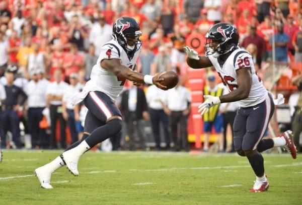 Houston Texans quarterback Deshaun Watson hands off to running back Lamar Miller during the first half against the Kansas City Chiefs.