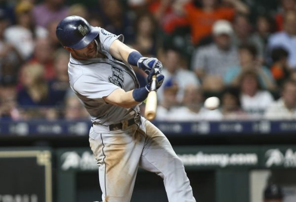 Seattle Mariners Mitch Haniger hits an RBI single during the sixth inning against the Houston Astros.