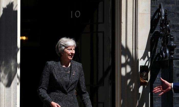 Britain's Prime Minister, Theresa May on the doorstep of 10 Downing Street, London, Britain July 24, 2018. (Reuters/Hannah McKay)