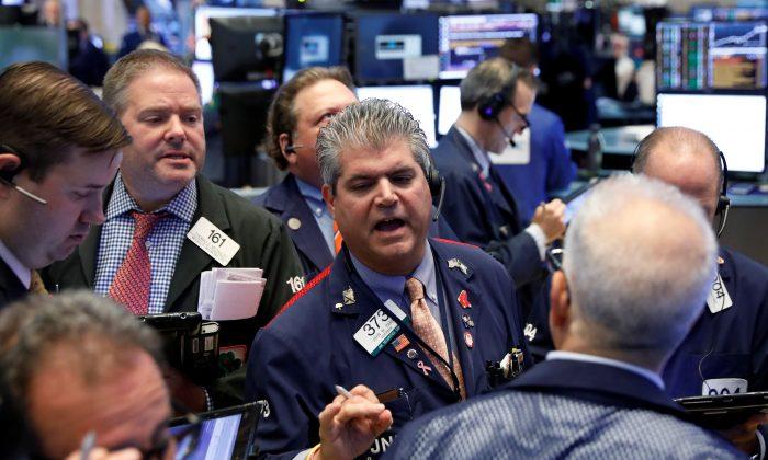 Traders work on the floor of the New York Stock Exchange on July 24, 2018. (Reuters/Brendan McDermid)