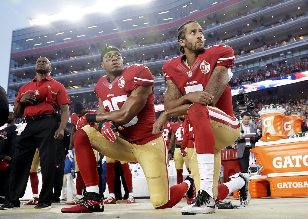 San Francisco 49ers safety Eric Reid (35) and quarterback Colin Kaepernick (7) kneel during the national anthem before an NFL football game against the Los Angeles Rams in Santa Clara, California on Sept. 12, 2016. (AP Photo/Marcio Jose Sanchez)