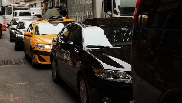 Cars drive through traffic in NYC.