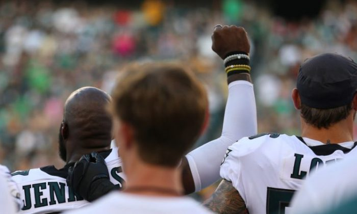 Malcolm Jenkins #27 of the Philadelphia Eagles raises his fist during the national anthem as Chris Long #56 puts his arm around him prior to the preseason game against the Pittsburgh Steelers at Lincoln Financial Field on Aug. 9, 2018 in Philadelphia, Pennsylvania. (Photo by Mitchell Leff/Getty Images)