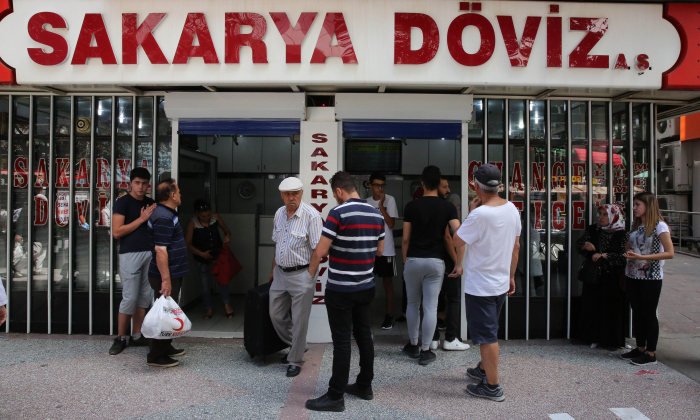 People look at foreign exchange rates in Ankara, Turkey, on  Aug. 10, 2018. (Adem Altan/AFP/Getty Images)