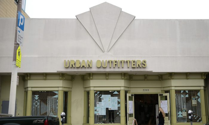 A pedestrian walks by an Urban Outfitter store on Aug. 18, 2014 in San Francisco, California. (Justin Sullivan/Getty Images)