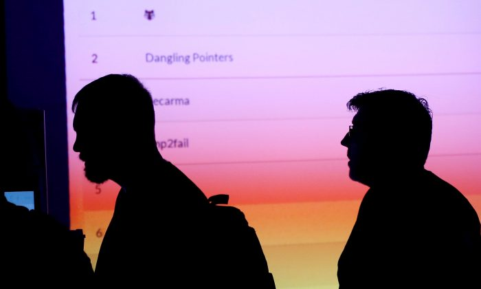 Participants are silhouetted as they pass through the IOT (Internet of Things) Village during the Def Con hacker convention in Las Vegas, Nevada, U.S., July 29, 2017. REUTERS/Steve Marcus/File Photo
