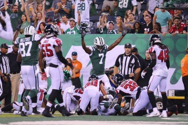 New York Jets wide receiver Tre McBride signals touchdown by running back Isaiah Crowell against the Atlanta Falcons during the first half.
