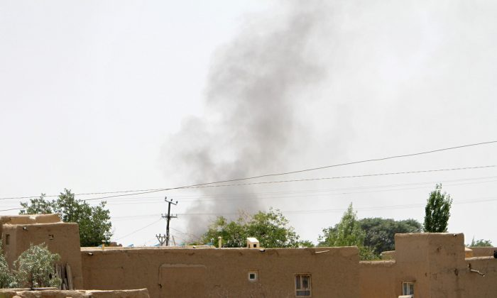 Smoke rises from a residential area where gun battle is going on between Taliban and Afghan forces in Ghazni province, Afghanistan on Aug. 10, 2018. (REUTERS/Stringer)