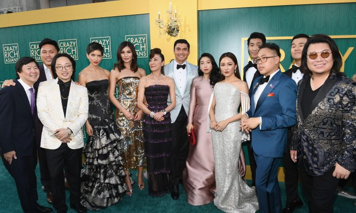 "(L-R) The cast of ""Crazy Rich Asians"" Ken Jeong, Jon M. Chu, Jimmy O. Yang, Sonoya Mizuno, Gemma Chan, Michelle Yeoh, Henry Golding, Awkwafina, Constance Wu, Chris Pang, Nico Santos, Ronny Chieng, and author Kevin Kawn arrive at Warner Bros. Pictures' ""Crazy Rich Asians"" Premiere at TCL Chinese Theatre IMAX on August 7, 2018 in Hollywood, California. (Photo by Emma McIntyre/Getty Images)"