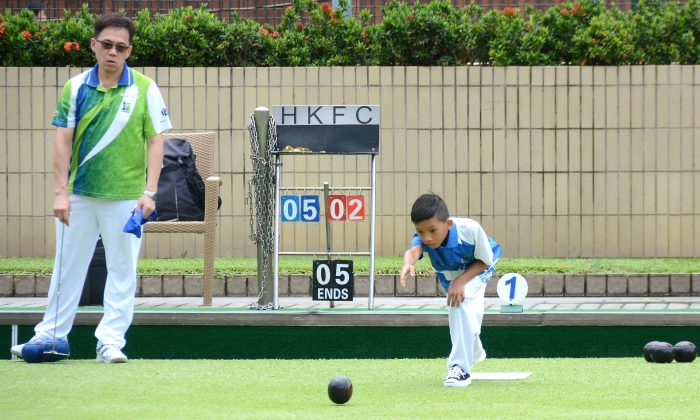 Nine years old Aldo Wong is the youngest player in the Hong Kong International Bowls Classic singles qualifying match.  He played against Canny Cheung from Tseung Kwan O Bowling Club.  Wong lost in the tie-breaker and failed to qualify. (Stephanie Worth)