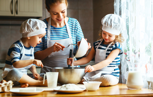 Let the little ones get their hands dirty in the kitchen. (Evgeny Atamanenko/Shutterstock)