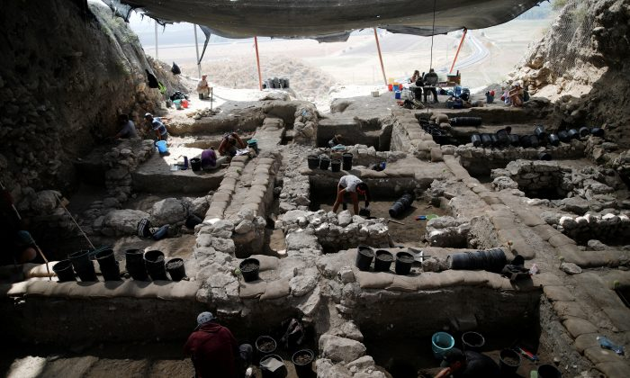 Workers dig at the Tel Megiddo Archaeological site in northern Israel on July 24. (REUTERS/Amir Cohen)