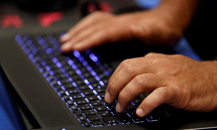 A man typing.