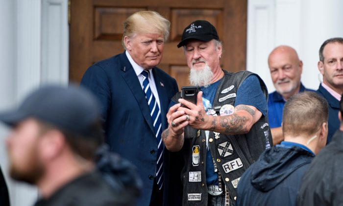 President Donald Trump takes a selfie with a supporter during a Bikers for Trump event at the Trump National Golf Club in Bedminster, New Jersey on Aug. 11, 2018. (BRENDAN SMIALOWSKI/AFP/Getty Images)