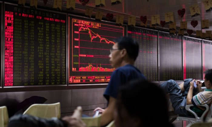 An investor looks at a personal terminal at a securities company in Beijing on July 9, 2015. (Greg Baker/AFP/Getty Images)