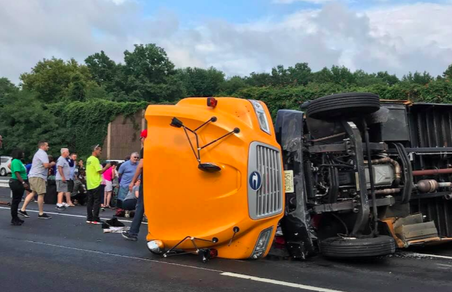 A school bus carrying 42 children and adults flipped on the New Jersey Turnpike near East Brunswick on Aug. 11, 2018. (Lisa Mezger Bochicchio via Storyful)