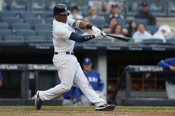 New York Yankees third baseman Miguel Andujar hits a two run home run against the Texas Rangers during the seventh inning.
