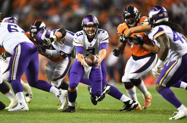Minnesota Vikings quarterback Trevor Siemian tosses the ball in the second quarter against the Denver Broncos. (Ron Chenoy/USA Today Sports)