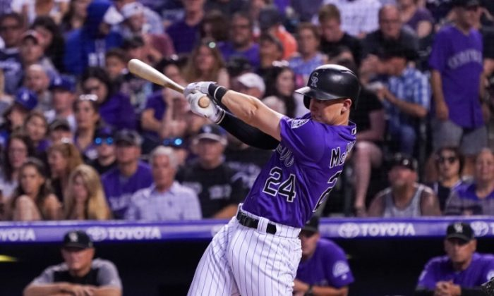 Colorado Rockies third baseman Ryan McMahon hits a single during the seventh inning of game against the Los Angeles Dodgers. (Troy Babbitt/USA Today Sports)