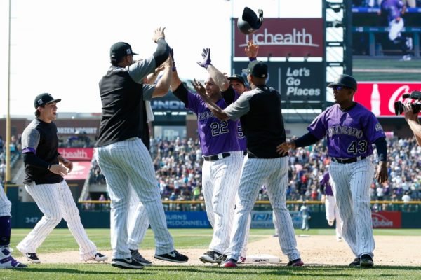 Colorado Rockies catcher Chris Iannetta celebrates with teammates after his bases loaded walk off walk RBI in the ninth inning against the Los Angeles Dodgers.