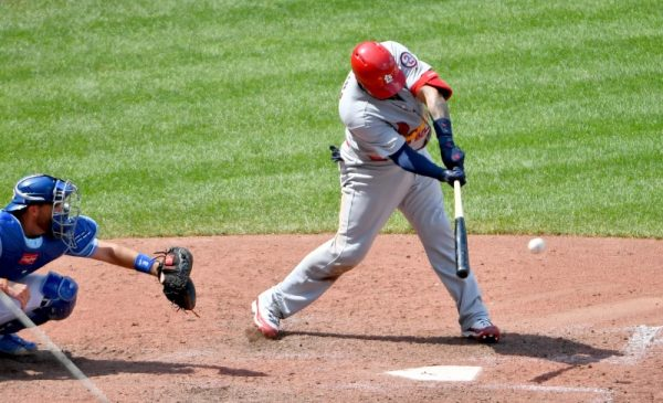 St. Louis Cardinals catcher Yadier Molina connects for a two run single in the seventh inning against the Kansas City Royals.
