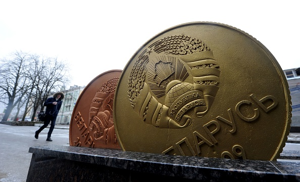 A man walks past the giant Belarusian ruble coin monument near the Ministry of taxes-and-duties in Minsk, on Feb. 22, 2017.  (SERGEI GAPON/AFP/Getty Images)