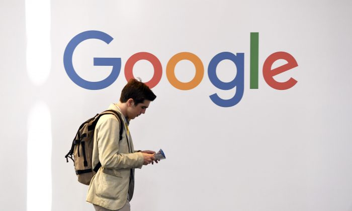 A man walks past the logo of the US multinational technology company Google during the VivaTech trade fair ( Viva Technology), in Paris on May 24, 2018. (ALAIN JOCARD/AFP/Getty Images)