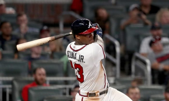 Atlanta Braves Ronald Acuna Jr. hits an RBI single scoring shortstop Dansby Swanson in the sixth inning against the Miami Marlins. (Jason Getz/USA Today Sports)