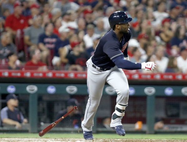 Cleveland Indians pinch hitter Yandy Diaz hits an RBI double against the Cincinnati Reds during the sixth inning.