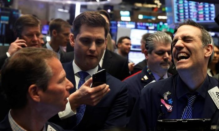 Traders on the floor of the New York Stock Exchange in New York, U.S., April 3, 2018.