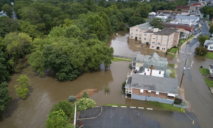 Flood waters surround homes along West Main Street in Schuylkill Haven, Pa., on Monday, Aug. 13, 2018. (David McKeown/Republican-Herald/AP)