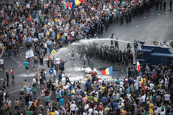 Riot police use water cannon against protesters in front of the Romanian Government headquarters in Bucharest, Romania on Aug. 10, 2018.        (ADRIAN CATU/AFP/Getty Images)
