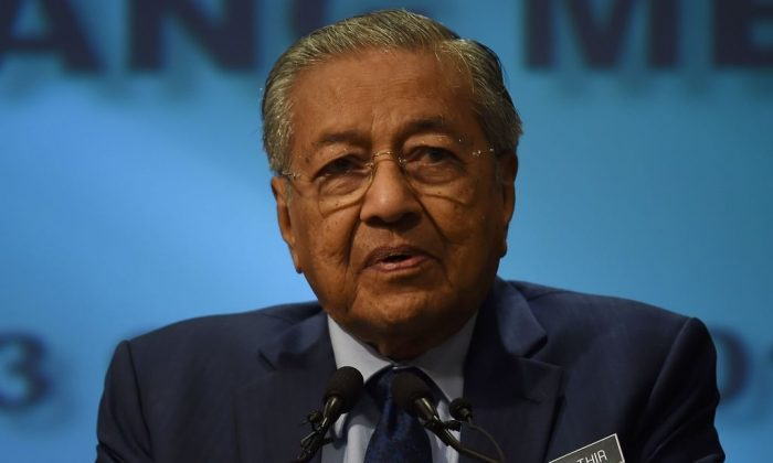 Malaysia's Prime Mininster Mahathir Mohamad addresses a press conference at the prime minister's office in Putrajaya, on Aug. 13, 2018. (Manan Vatsyayana/AFP/Getty Images)