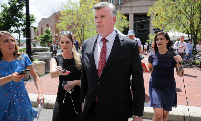 Kevin Downing (C), lead attorney for Paul Manafort, is pursued by reporters after leaving the Albert V. Bryan U.S. Courthouse during the eleventh day of Manafort's trial August 14, 2018 in Alexandria, Virginia. (Chip Somodevilla/Getty Images)
