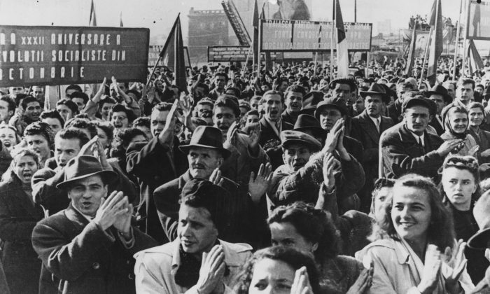 A crowd in Victory Square, Bucharest, Romania, on the 32nd anniversary of the Russian Revolution. (Keystone/Getty Images)